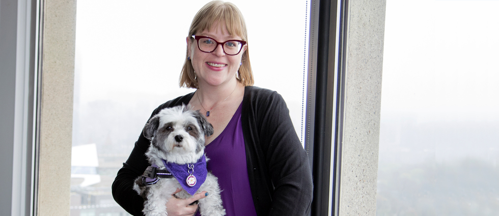 Grad Emily Wright draws on her experiences and service dog to teach students about empathy and homelessness